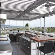 The commercial look of the kitchen is reinforced interior design, real estate, roof, white, gray