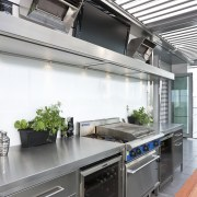 The commercial look of the kitchen is reinforced countertop, interior design, kitchen, gray, white