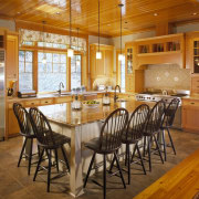 View of kitchen featuring antique heart pine tongue countertop, dining room, estate, floor, flooring, hardwood, home, interior design, kitchen, real estate, room, table, wood, wood flooring, brown, orange