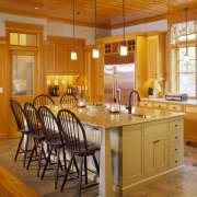 View of kitchen featuring antique heart pine tongue cabinetry, ceiling, countertop, cuisine classique, dining room, floor, flooring, hardwood, home, interior design, kitchen, real estate, room, table, wood, wood flooring, brown, orange