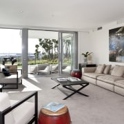 View of the open plan living area featuring house, interior design, living room, property, real estate, window, gray