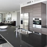 View of the open plan living area featuring countertop, interior design, kitchen, white, black, gray