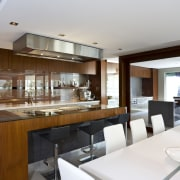 View of the kitchen featuring teak painted cabinetry, countertop, house, interior design, kitchen, real estate, white, gray, brown