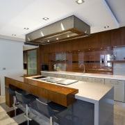 View of kitchen with stainless steel ventilation, stone architecture, countertop, daylighting, house, interior design, kitchen, real estate, table, gray