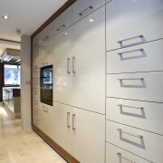 View of painted teak cabinetry. - View of glass, interior design, wall, gray