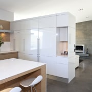 View of kitchen and living area featuring light architecture, countertop, cuisine classique, floor, interior design, kitchen, real estate, room, white, gray