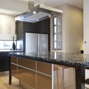 So this area looks good even when the cabinetry, countertop, cuisine classique, floor, hardwood, interior design, kitchen, room, wood flooring, gray