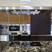 So this area looks good even when the cabinetry, countertop, cuisine classique, interior design, kitchen, black, white