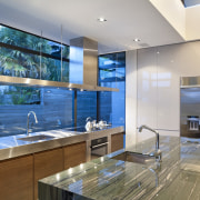 View of kitchen featuring american walnut base cabinets, countertop, interior design, kitchen, real estate, gray