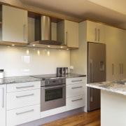 A new layout ensures views take priority.Mood lighting cabinetry, countertop, cuisine classique, floor, flooring, hardwood, interior design, kitchen, laminate flooring, real estate, room, wood flooring, orange