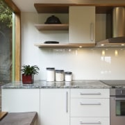 A new layout ensures views take priority.Mood lighting cabinetry, countertop, cuisine classique, hardwood, interior design, kitchen, room, gray, brown