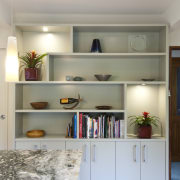 A new layout ensures views take priority.Mood lighting cabinetry, countertop, floor, furniture, hardwood, home, interior design, kitchen, living room, room, shelf, shelving, wall, gray
