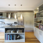 A new layout ensures views take priority.Mood lighting cabinetry, countertop, cuisine classique, interior design, kitchen, room, gray, white