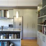 A new layout ensures views take priority.Mood lighting cabinetry, countertop, floor, flooring, hardwood, interior design, kitchen, room, shelf, shelving, wood flooring, gray