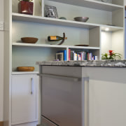 A new layout ensures views take priority.Mood lighting cabinetry, countertop, home appliance, interior design, kitchen, major appliance, refrigerator, room, shelf, shelving, gray