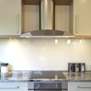 A new layout ensures views take priority.Mood lighting cabinetry, countertop, cuisine classique, home appliance, interior design, kitchen, kitchen stove, room, under cabinet lighting, white