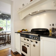 View of Falcon oven and cooktop and lacquered cabinetry, countertop, cuisine classique, floor, flooring, home, home appliance, interior design, kitchen, kitchen appliance, kitchen stove, property, real estate, room, wood flooring, gray