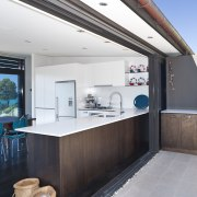 View of kitchen featuring white cabinets, beefeater barbeque house, interior design, real estate, white
