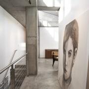 View of the upper level corridor featuring concrete ceiling, daylighting, exhibition, floor, flooring, interior design, tourist attraction, white, gray