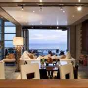 View of the living space featuring Capri, Design apartment, interior design, living room, real estate, restaurant, brown