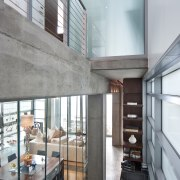View of hall space featuring concrete floors and architecture, ceiling, daylighting, house, interior design, loft, white, gray