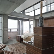 View of the master bedroom featuring concrete floors, architecture, furniture, house, interior design, window, gray, black, white