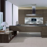 Designed by Hacker Kitchens, this kitchen features appliances cabinetry, countertop, floor, flooring, furniture, interior design, kitchen, living room, product design, gray, black