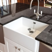 This new kitchen, by RH Cabinetmakers, features traditionally bathroom, bathroom cabinet, bathroom sink, cabinetry, countertop, floor, kitchen, plumbing fixture, room, sink, tap, wood stain, white