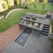View of outdoor living space by Nathan Burkett architecture, backyard, courtyard, floor, garden, grass, landscape, landscaping, outdoor structure, patio, real estate, residential area, urban design, walkway, yard, gray