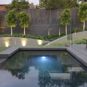 View of outdoor living space by Nathan Burkett architecture, backyard, condominium, estate, landscaping, property, real estate, reflecting pool, reflection, swimming pool, water, water feature, gray, black