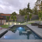 View of outdoor living space by Nathan Burkett architecture, backyard, estate, home, house, landscaping, property, real estate, reflecting pool, reflection, residential area, swimming pool, water, gray