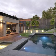 View of outdoor living space by Nathan Burkett architecture, backyard, estate, home, house, lighting, property, real estate, reflection, residential area, swimming pool, villa