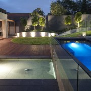 View of outdoor living space by Nathan Burkett architecture, backyard, estate, home, house, lighting, property, real estate, reflection, swimming pool, water, black