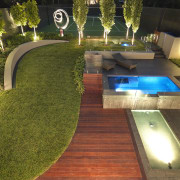 View of outdoor living space by Nathan Burkett architecture, backyard, estate, grass, landscape lighting, landscaping, lawn, lighting, plant, real estate, swimming pool, yard, brown