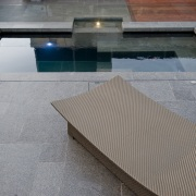View of outdoor living space by Nathan Burkett architecture, daylighting, floor, flooring, furniture, outdoor furniture, sunlounger, swimming pool, table, tile, wood, gray