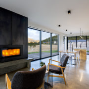 A built-in log fire contributes to the heating gray, black