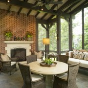 View of the lounge features large windows & dining room, furniture, home, interior design, living room, outdoor structure, patio, porch, real estate, table, brown