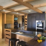 Ranch-style kitchen by Applegate Tran Interiors - Ranch-style architecture, ceiling, countertop, hardwood, house, interior design, kitchen, living room, real estate, wood flooring, brown