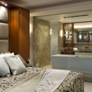 View of contemporary bedroom and bathroom divided by interior design, room, suite, brown, gray