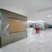 White marble was introduced for the flooring to architecture, ceiling, floor, interior design, lobby, real estate, gray