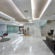 White marble was introduced for the flooring to architecture, ceiling, daylighting, floor, flooring, interior design, lobby, real estate, gray