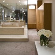View of contemporary bathroom with mirror wall, white architecture, ceiling, floor, flooring, interior design, lobby, gray, brown