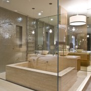 View of contemporary bathroom with mirror wall, white floor, flooring, glass, interior design, lobby, brown, gray
