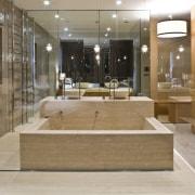 View of contemporary bathroom with mirror wall, white bathroom, floor, flooring, interior design, lobby, tile, brown, gray