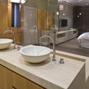 View of contemporary bathroom with mirror wall, white bathroom, countertop, interior design, room, sink, brown, gray