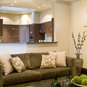 Close up of Lounge & kitchen area - ceiling, home, interior design, lighting, living room, room, wall, orange, brown