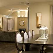 Close up of Dining room overlooking the lounge ceiling, dining room, floor, furniture, home, interior design, light fixture, lighting, living room, room, table, brown, orange