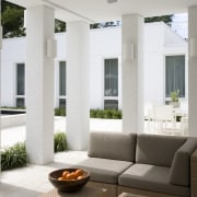 Outdoor relaxing area with pillars surrounding the furniture estate, furniture, home, interior design, living room, property, real estate, structure, window, gray