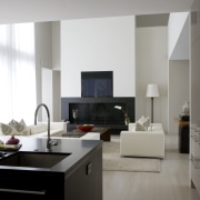 View of the lounge from the kitchen bench floor, interior design, interior designer, living room, room, table, white, gray