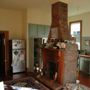View of this fireplace within this kitchen - fireplace, flooring, furniture, hearth, home, home appliance, house, interior design, living room, room, brown
